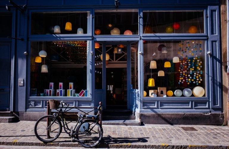 bicycle in front of small local business